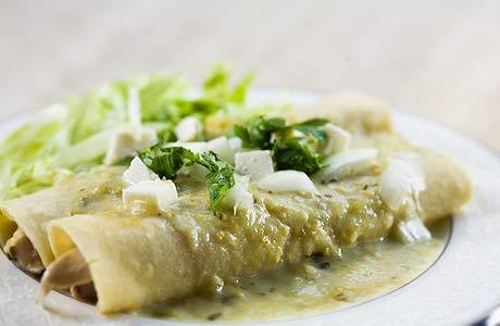 Salsa Verde Chicken and Black Bean Enchiladas with Feta and Sharp Cheddar cheese!